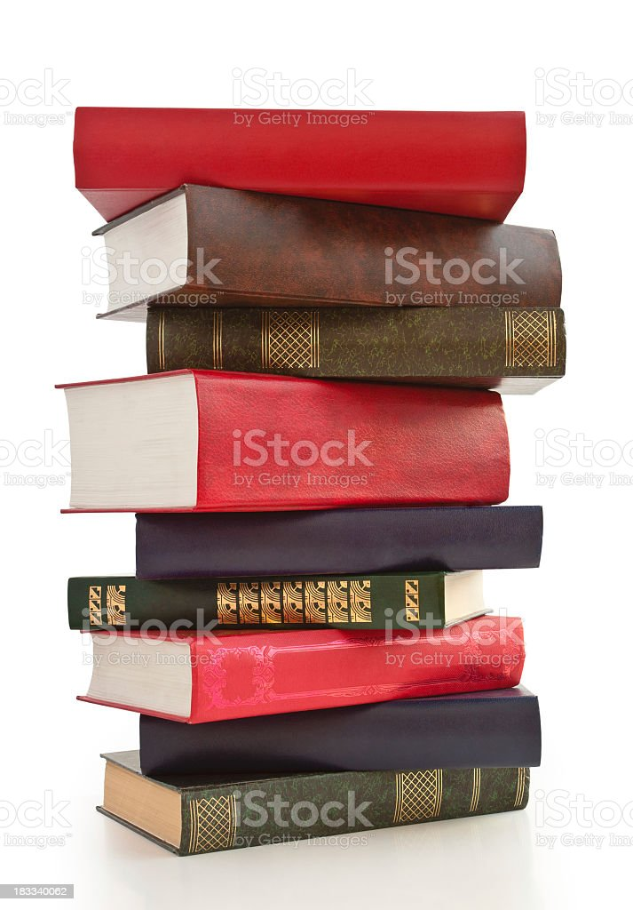 Colorful stack of a variety of books on a white surface royalty-free stock photo
