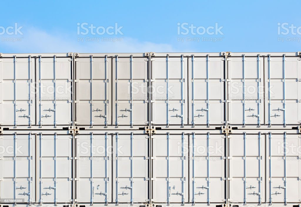 Colorful stack of container shipping at dockyard stock photo