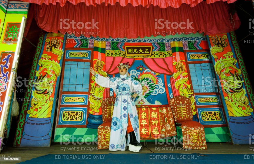 Colorful stage of chinese theater and one actor playing a role in a traditional dramatic play stock photo