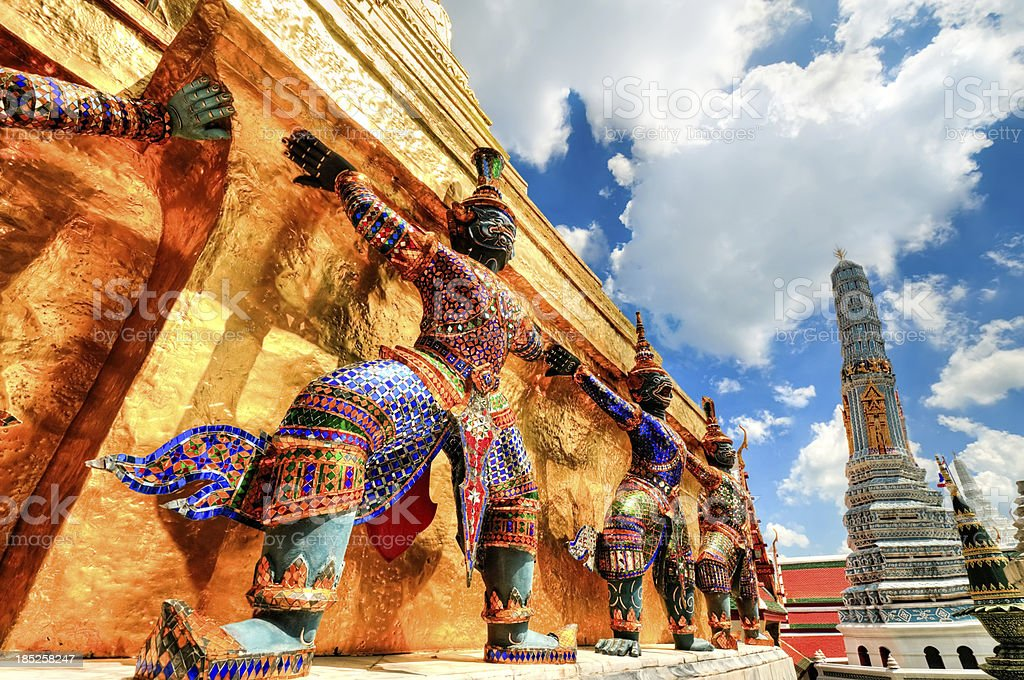 Colorful statues guarding temple at Wat Phra Kaew stock photo