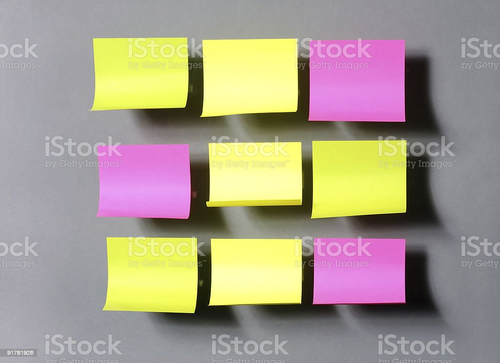 Colorful stickers on the grey background royalty-free stock photo