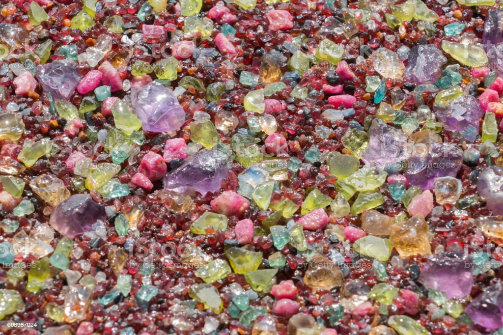 Colorful stones background - pile of semi precious jewelery stones stock photo