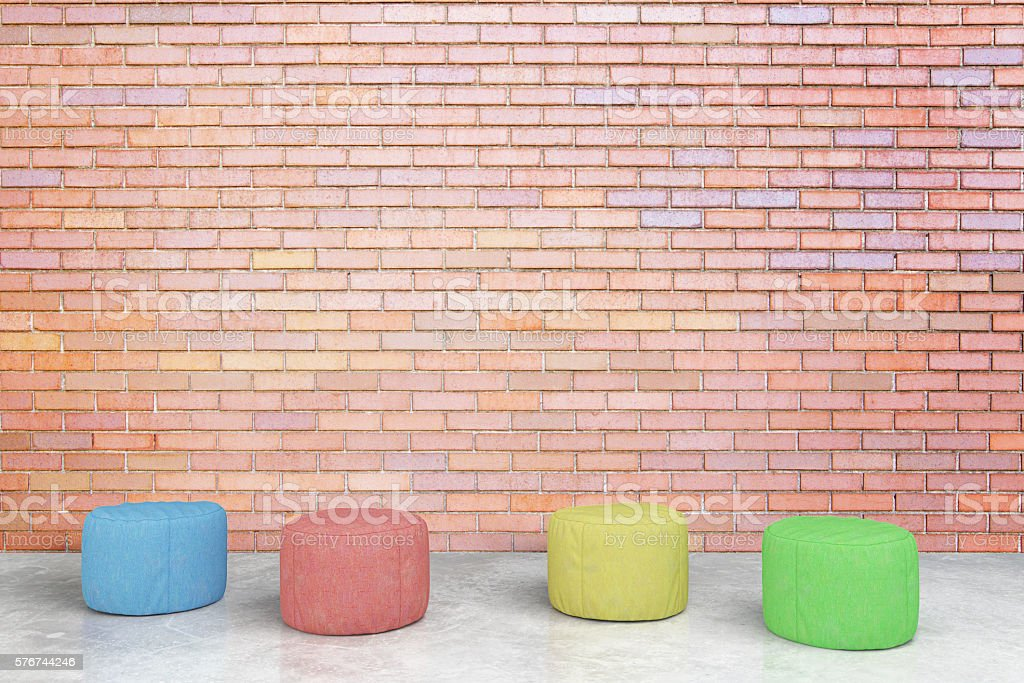 Colorful stools in brick room stock photo