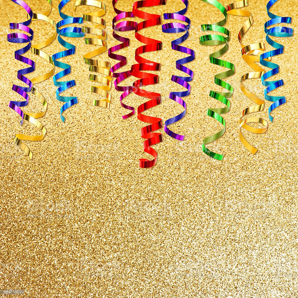colorful streamer over golden background. party decoration stock photo
