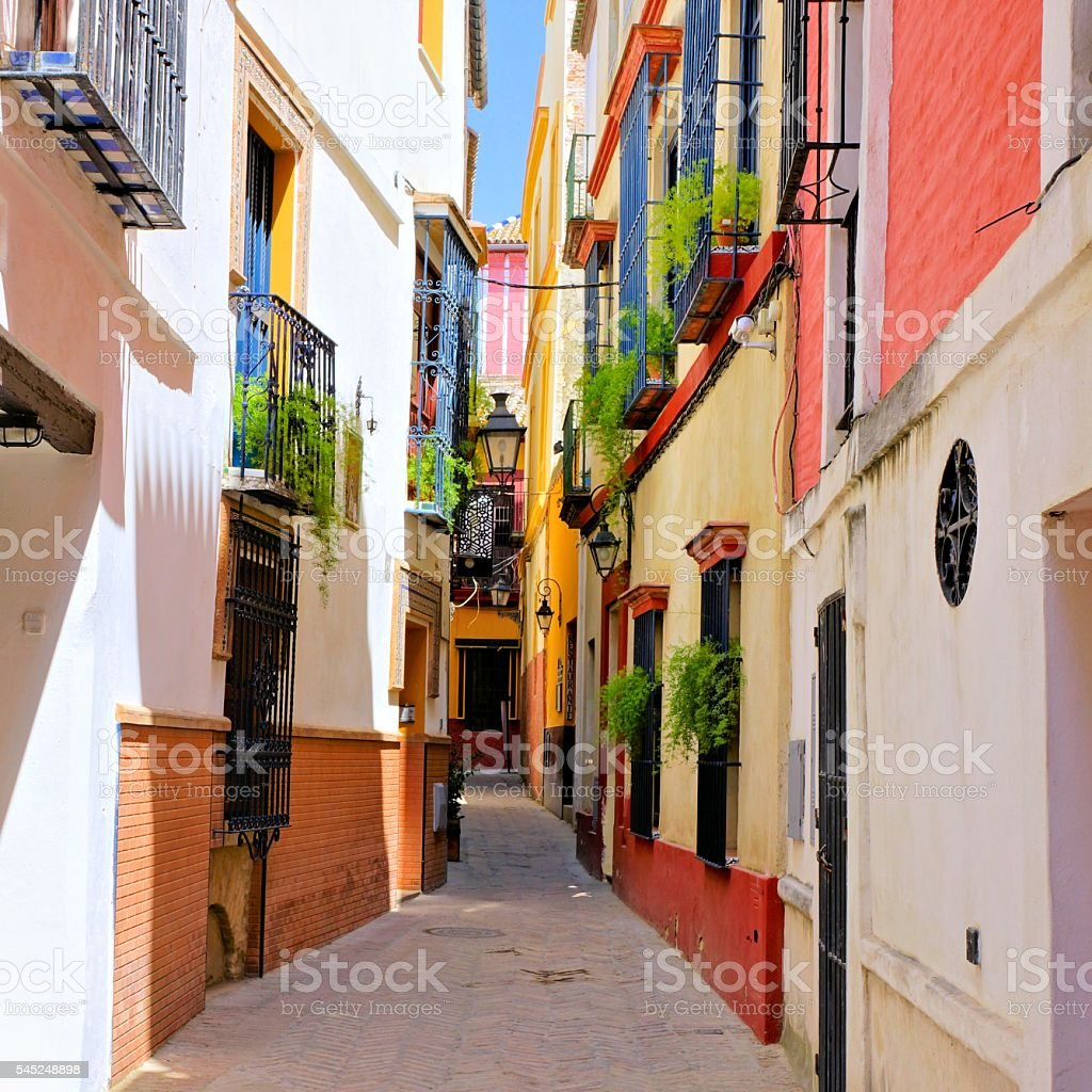 Colorful street in the old town of Sevilla, Spain stock photo