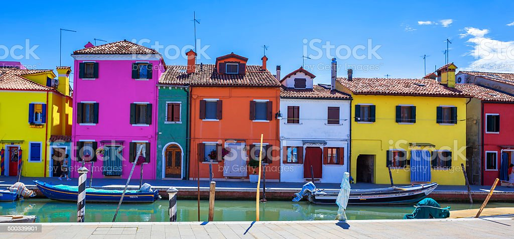 Colorful street with canal in Burano stock photo