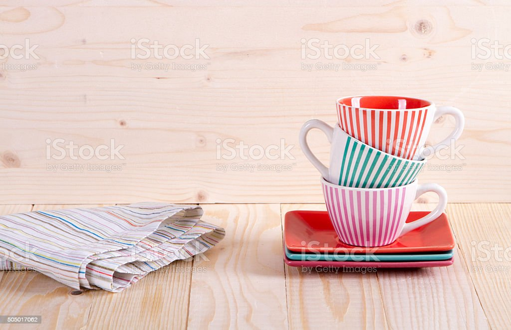 Colorful striped coffee cups stock photo