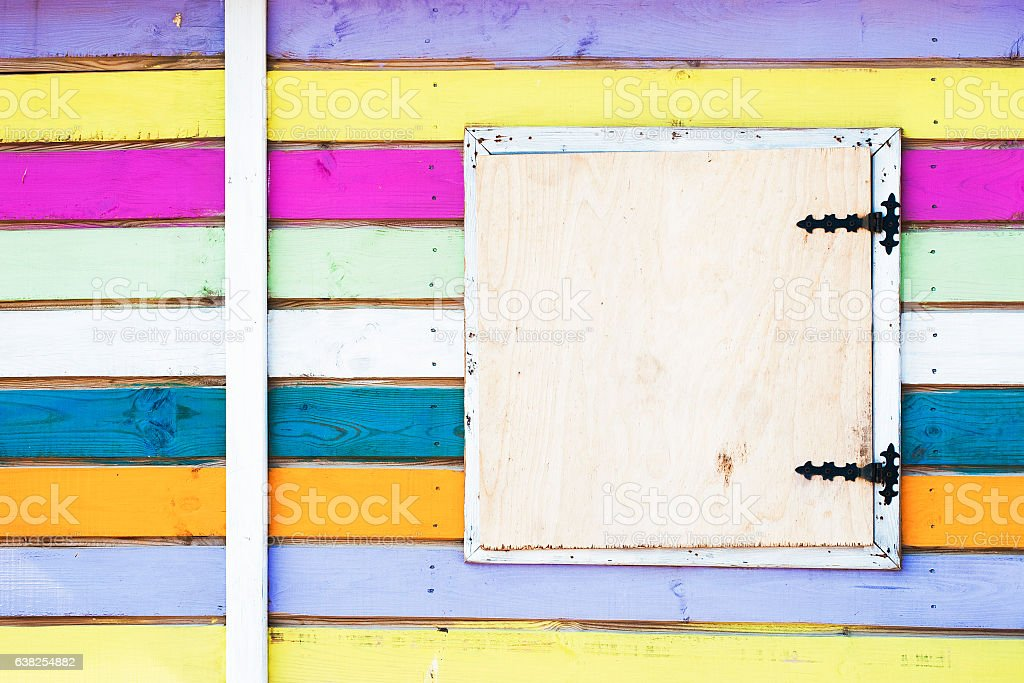 Colorful striped wall of a beach house. stock photo