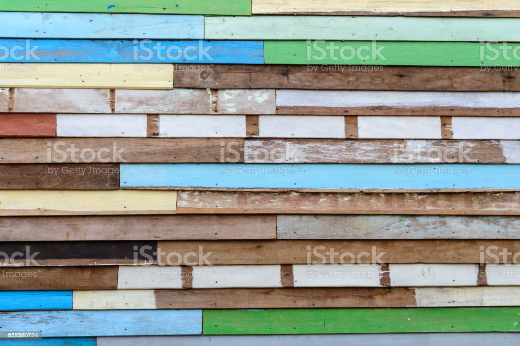 Colorful striped wooden wall stock photo