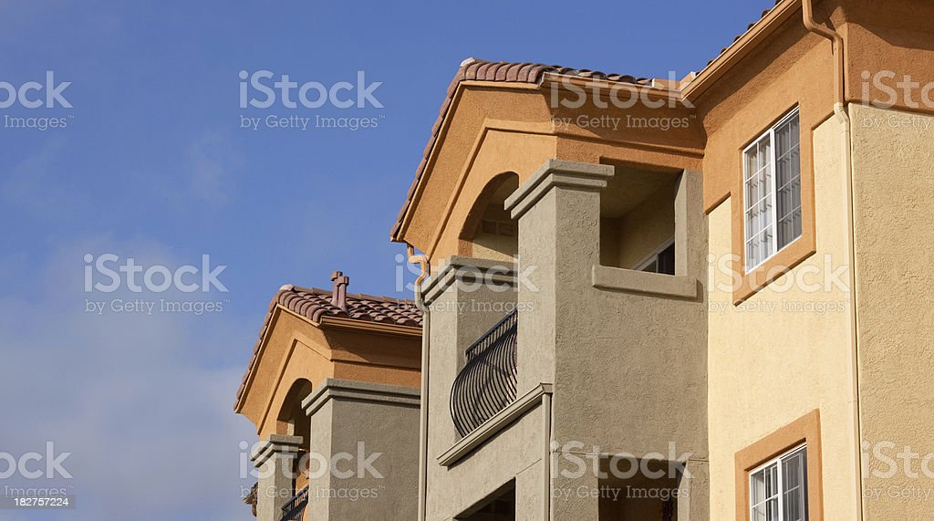 Colorful Stucco Apartment Building Exterior and Sky royalty-free stock photo