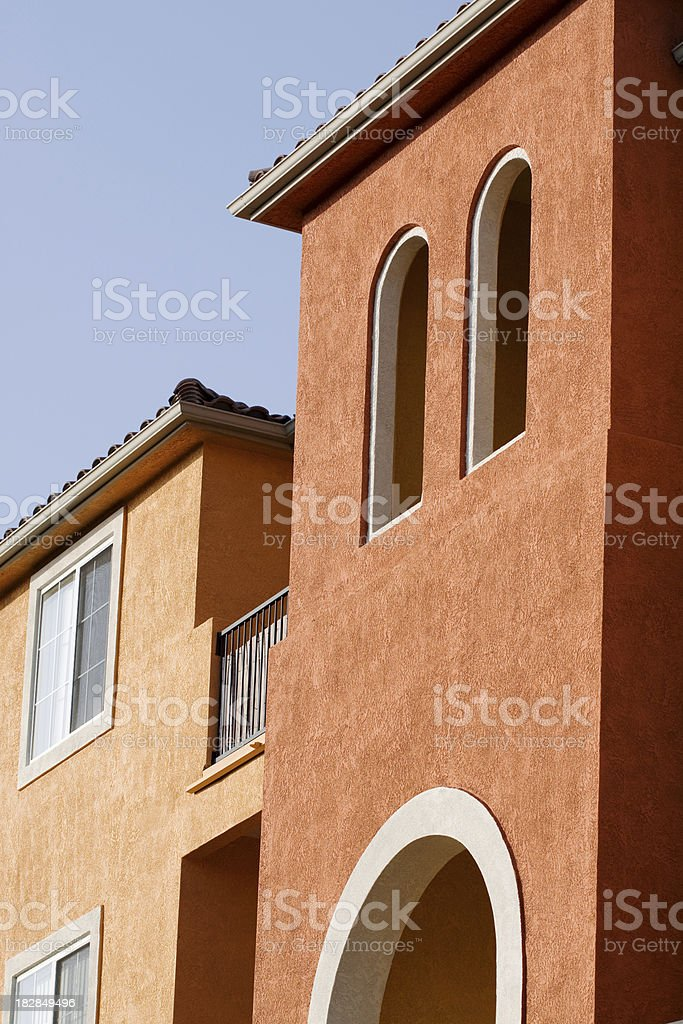 Colorful Stucco Apartment Building Exterior royalty-free stock photo