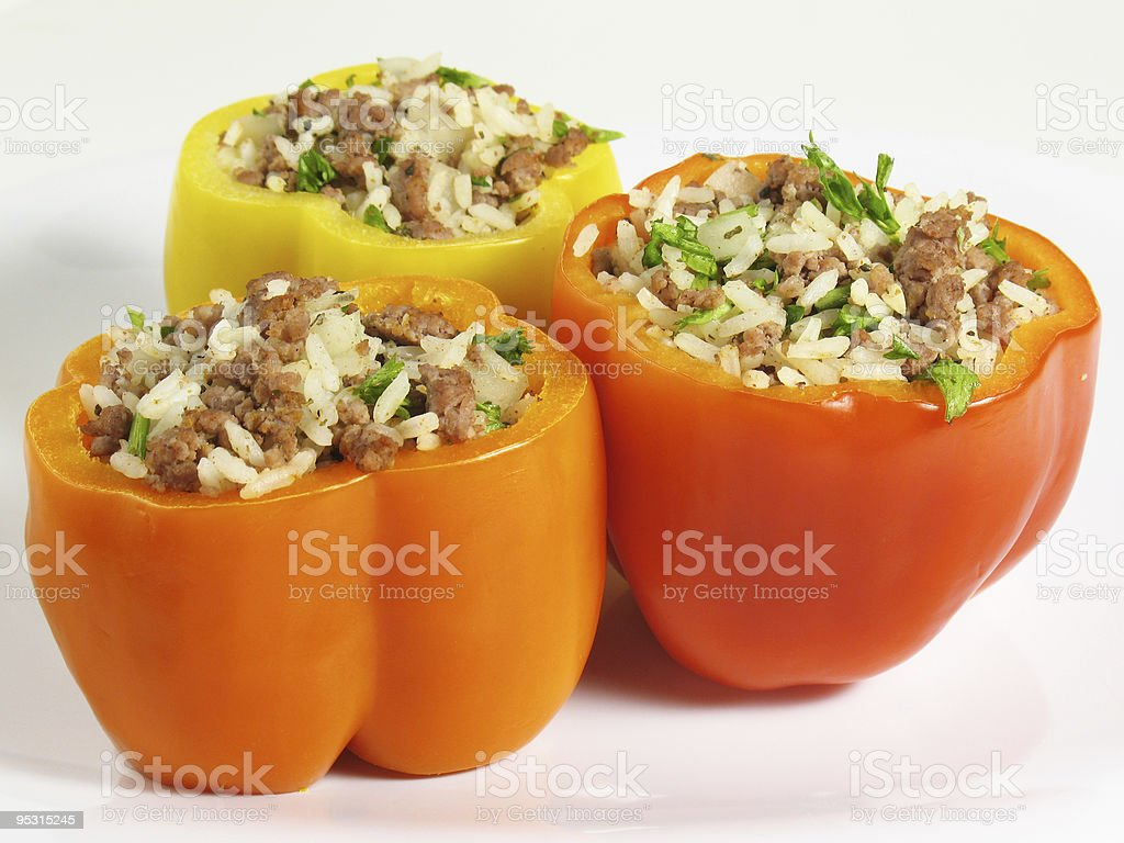 Colorful stuffed peppers with mince, herbs and rice stock photo