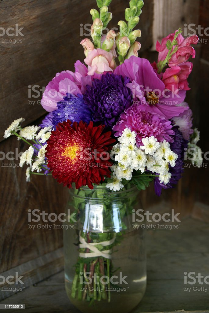 Colorful Summer Bouquet in a Mayonaise Jar royalty-free stock photo