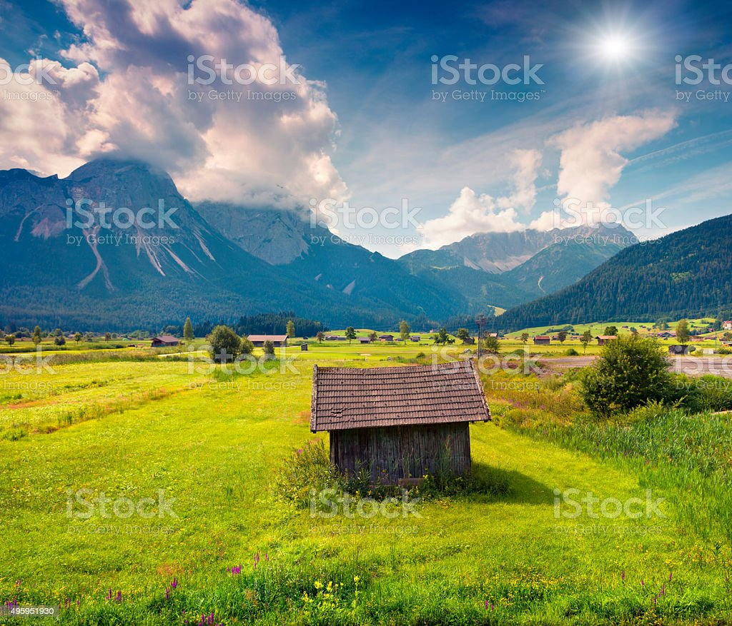 Colorful summer morning on the Golf club Zugspitze stock photo