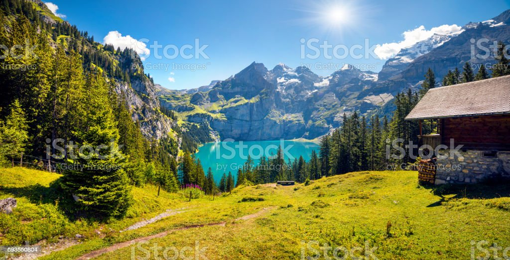 Colorful summer morning on unique lake - Oeschinen (Oeschinensee) stock photo