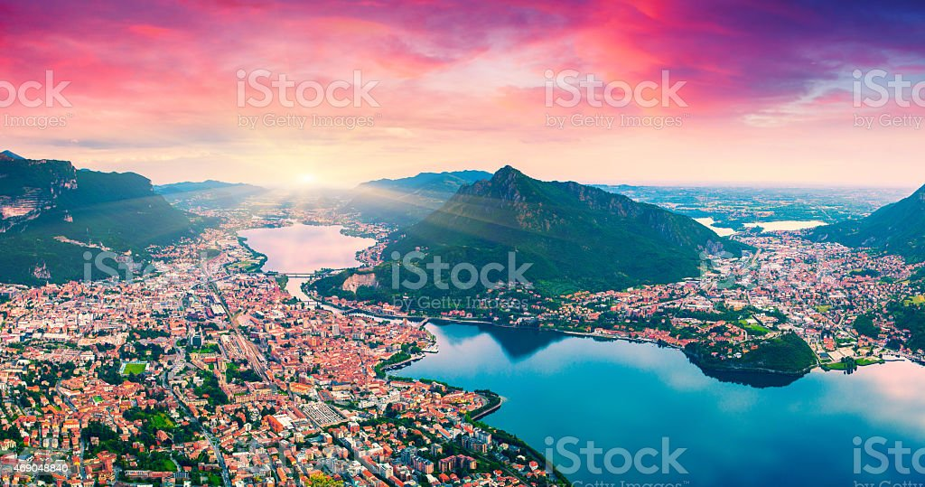 Colorful summer sunrise on the city and lake Lecco stock photo