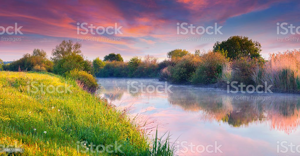 Colorful summer sunrise on the river stock photo