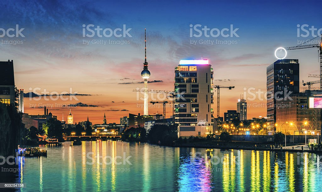 colorful summer sunset over berlin river with view on tv-tower stock photo
