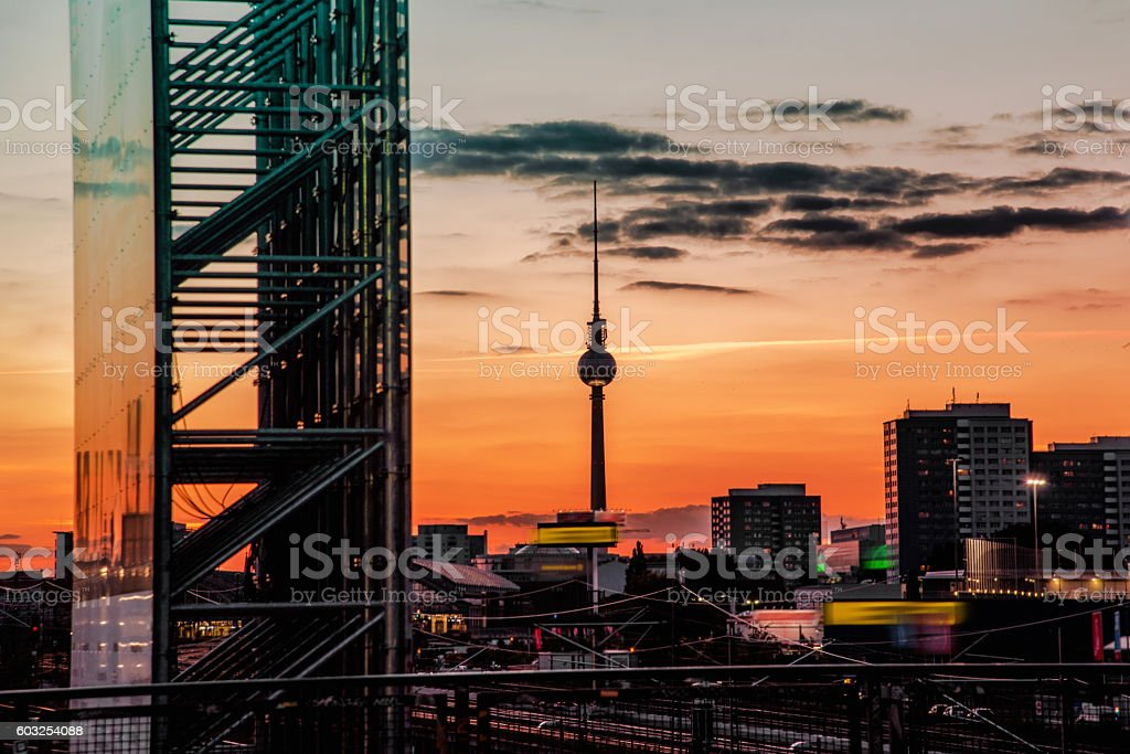 colorful summer sunset over berlin with view on tv-tower stock photo