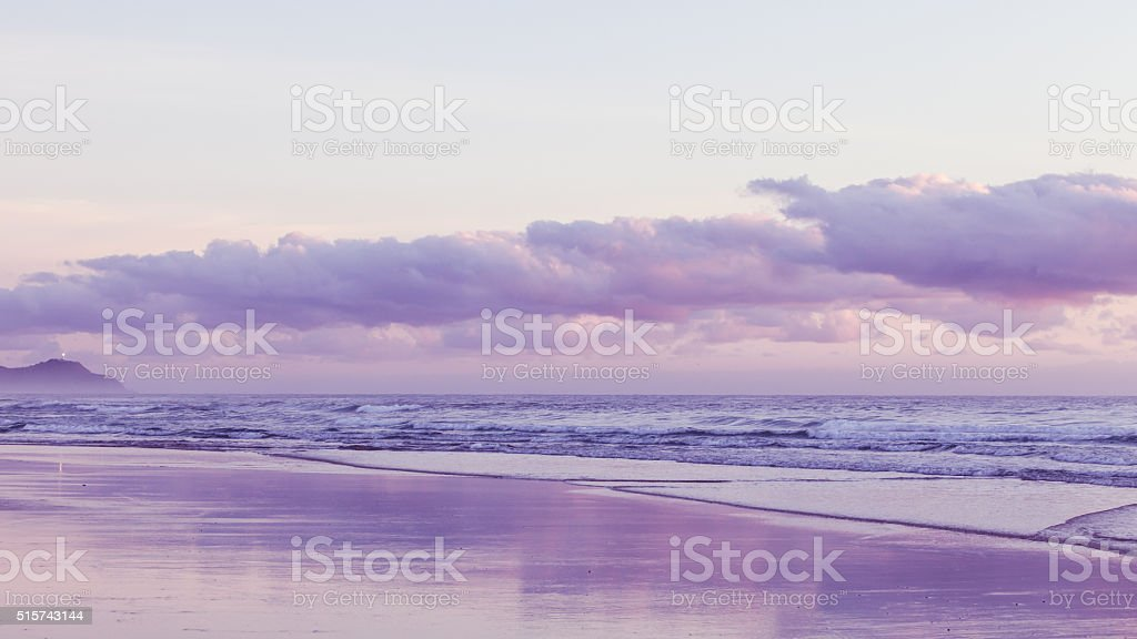 Colorful sunrise at the beach stock photo
