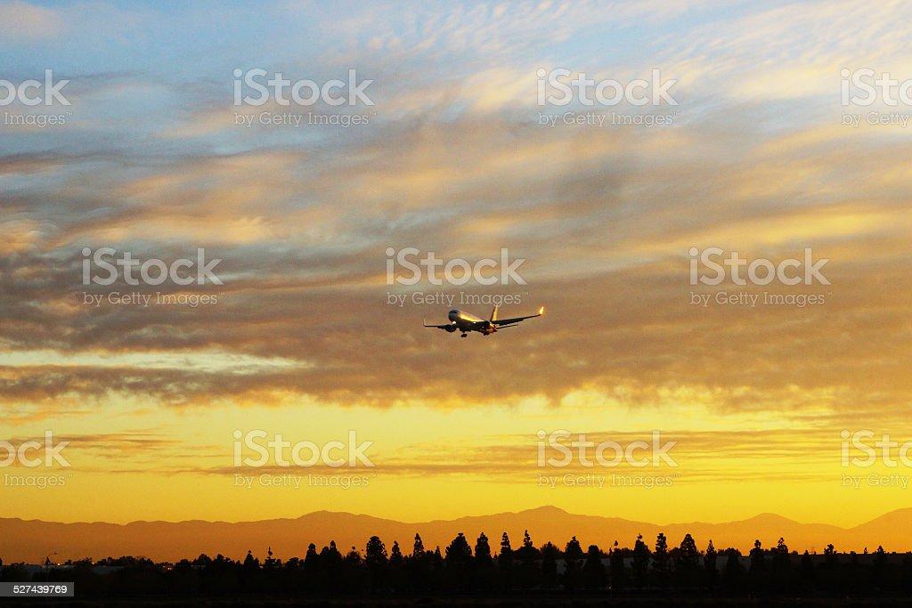 Colorful Sunrise Jet Airplane Landing stock photo