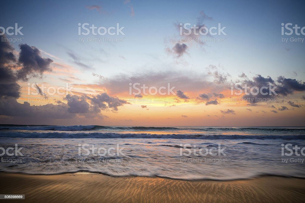 Colorful sunset at the beach stock photo