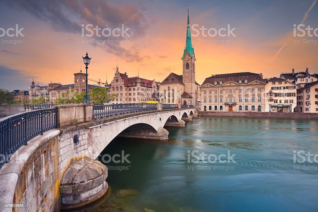 Colorful sunset behind the Zurich cityscape stock photo