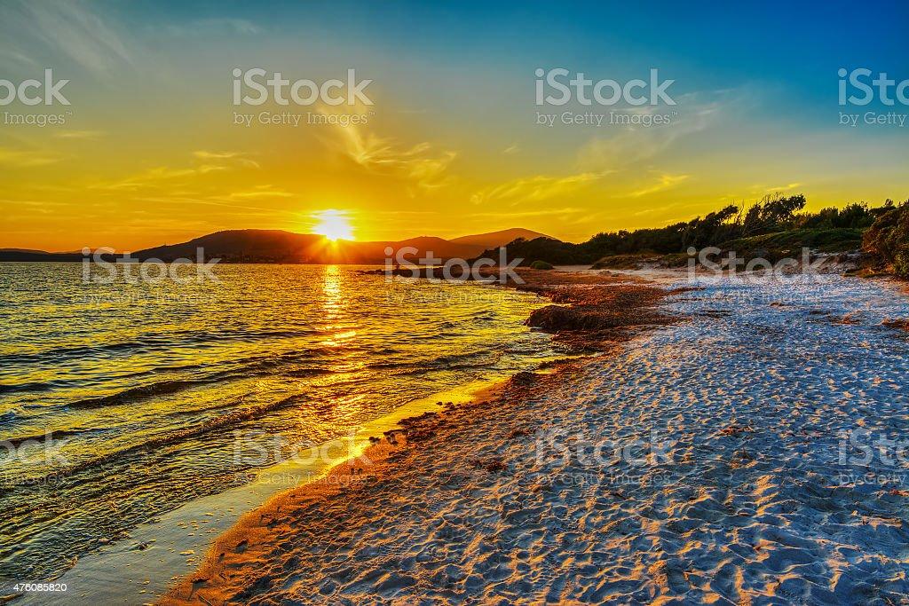 colorful sunset in Alghero shoreline stock photo