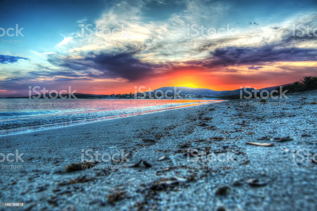 colorful sunset in Maria Pia beach stock photo