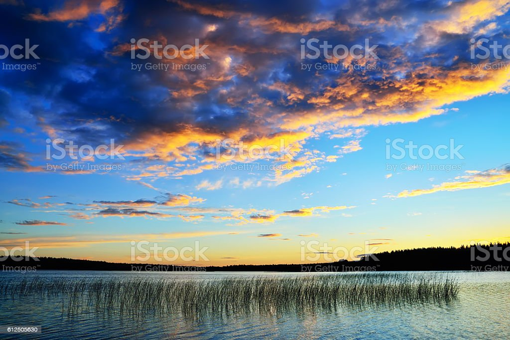 Colorful sunset. Lake Momsayarvi, Karelia, Russia stock photo