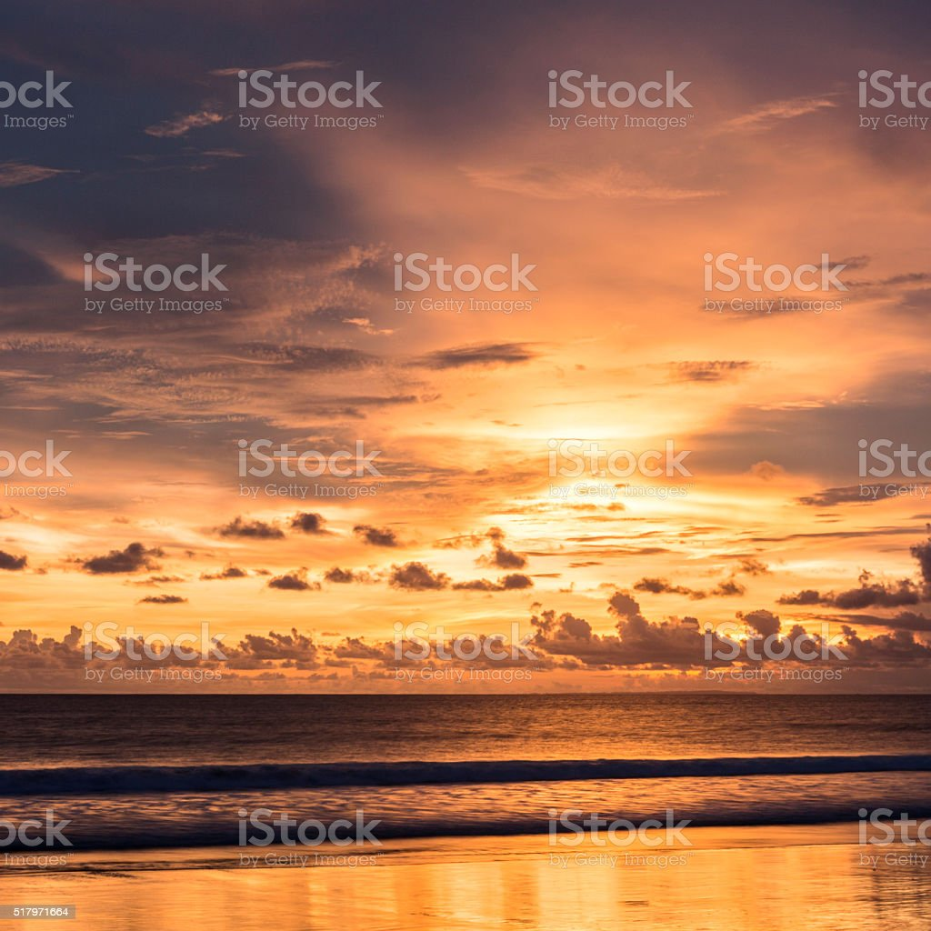 Colorful sunset on the beach stock photo