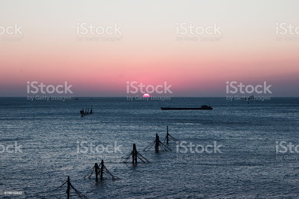 colorful sunset on the coast of the South China Sea stock photo