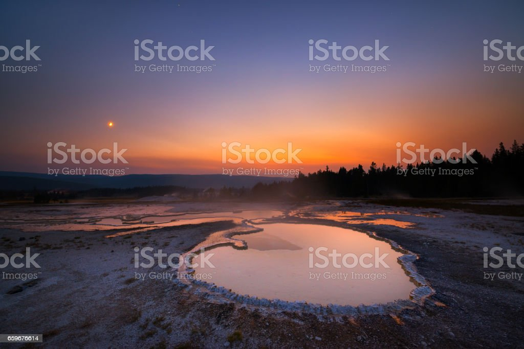 Colorful sunset over a hot spring in Yellowstone stock photo