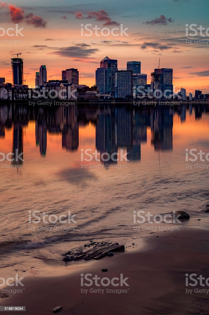 Colorful sunset over Canary Wharf, London skyline. stock photo