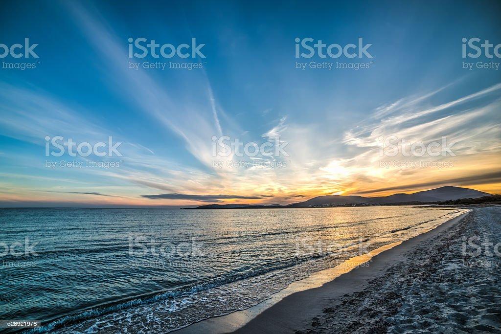 colorful sunset over Maria Pia beach stock photo