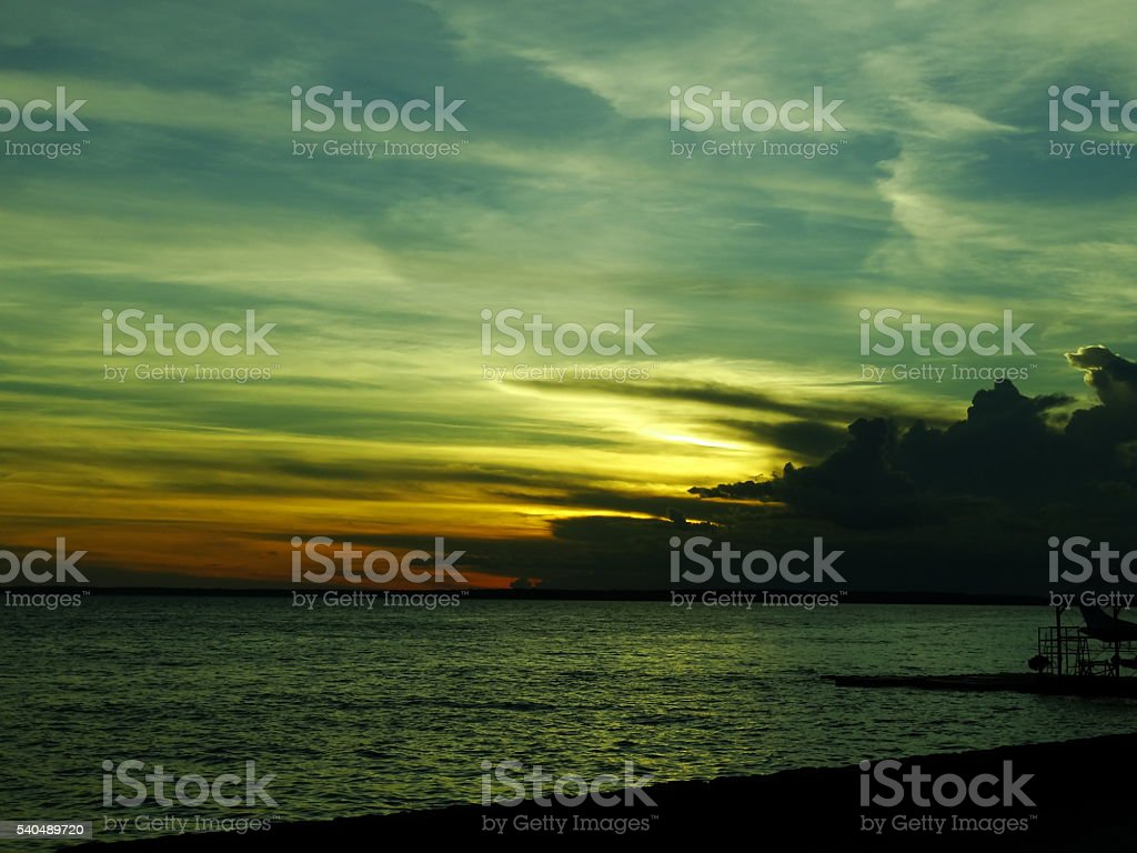 Colorful sunset over the Rio Negro in Amazonas. stock photo