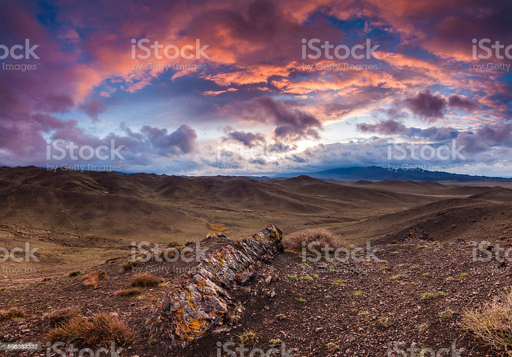 Colorful sunset over the rocky steppe. Mongolia. stock photo