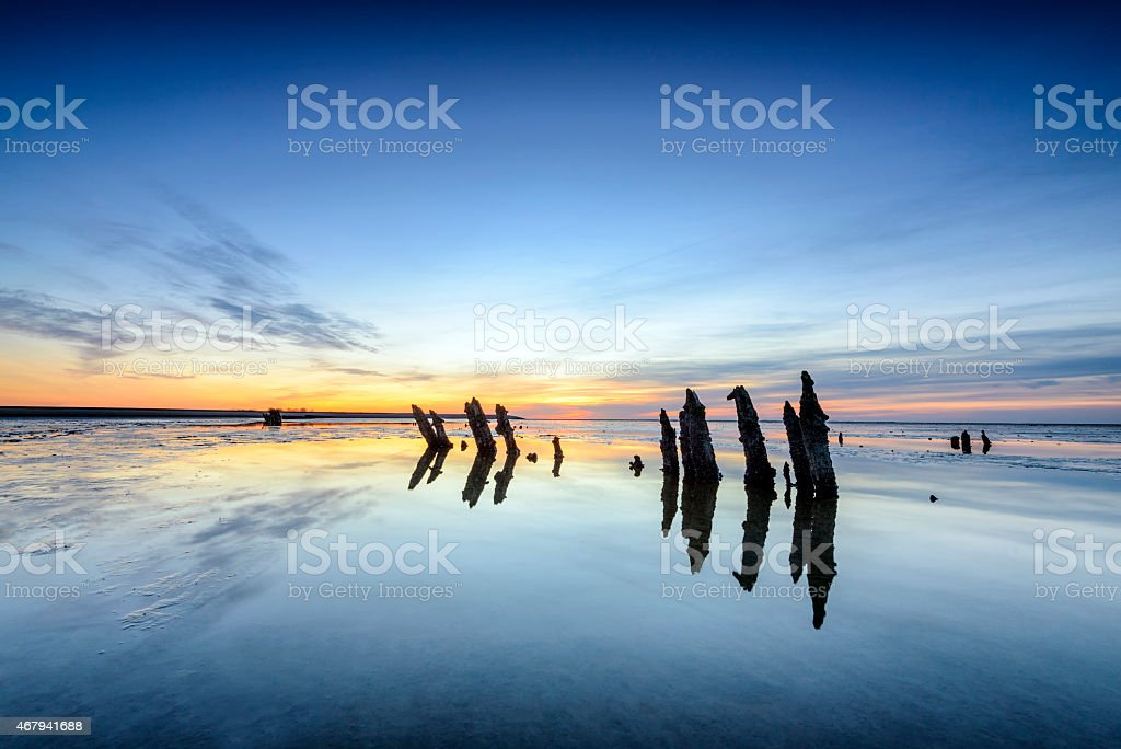 Colorful sunset over tidal sand flats in the Waddensea stock photo