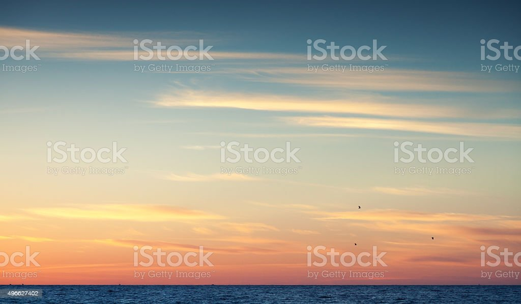 Colorful sunset sky over Atlantic ocea stock photo