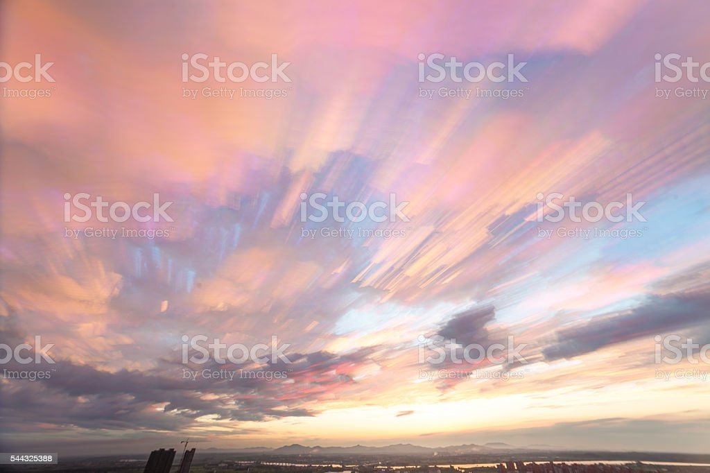 colorful sunset sky stacked clouds stock photo