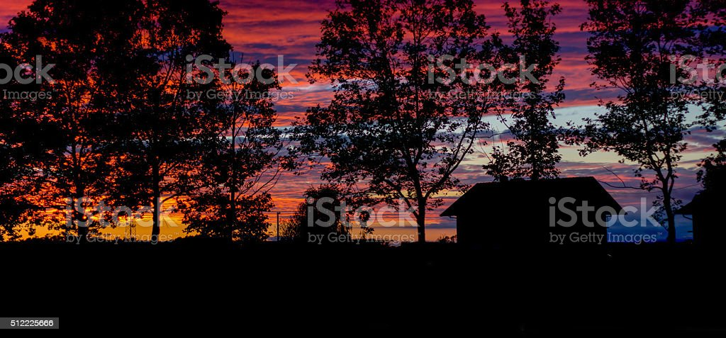Colorful sunset with silhouettes stock photo