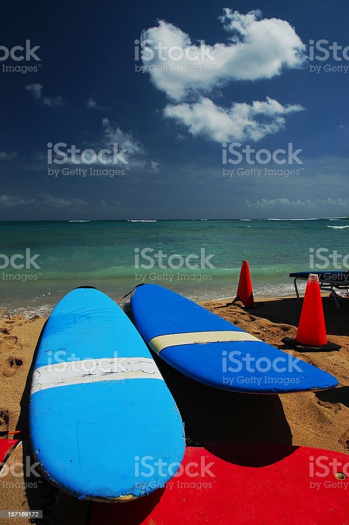 Colorful Surfboards on Beach in Oahu stock photo