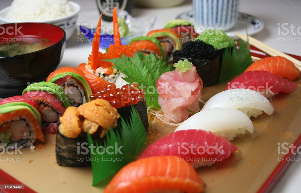 A colorful sushi tray on a wooden board royalty-free stock photo