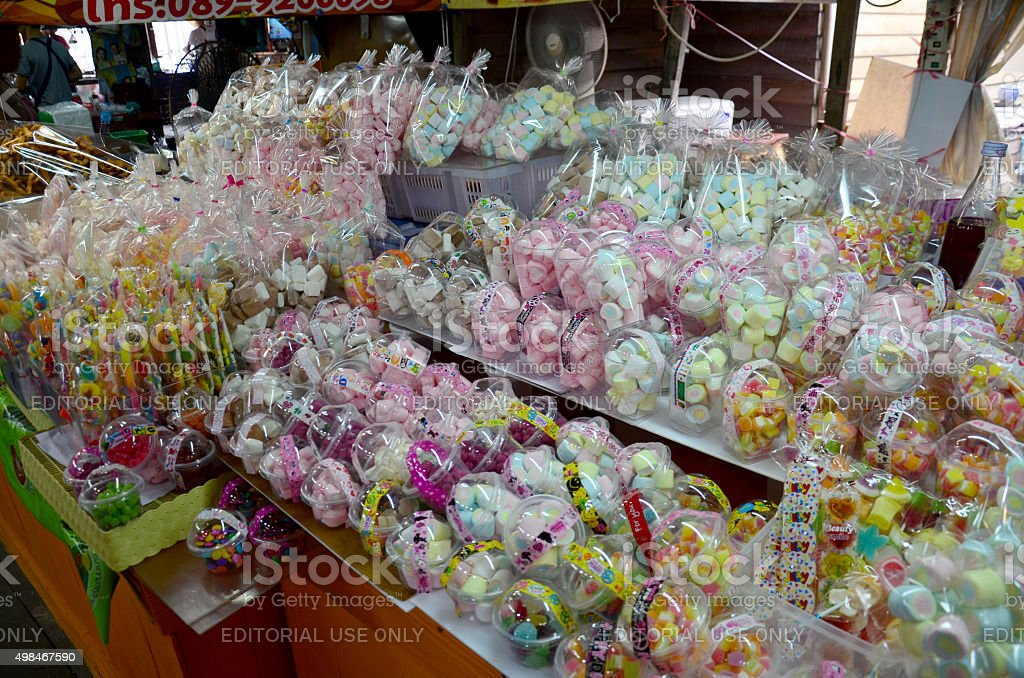 Colorful sweet snack and candy shop for sale stock photo