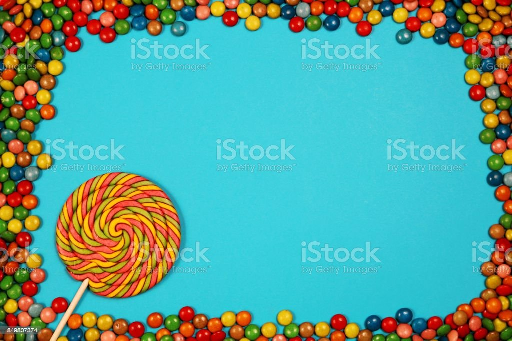 Colorful sweets and lollipops on blue background stock photo