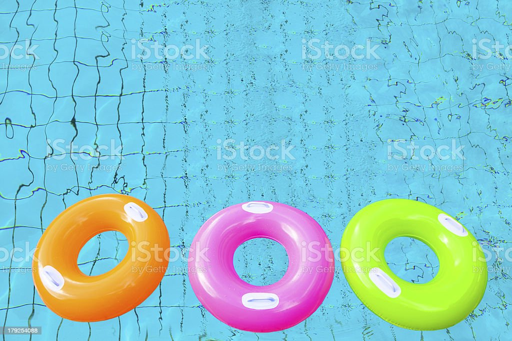 colorful swimming pool rings on the water royalty-free stock photo