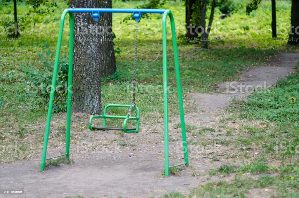 Colorful swing in the rural park stock photo