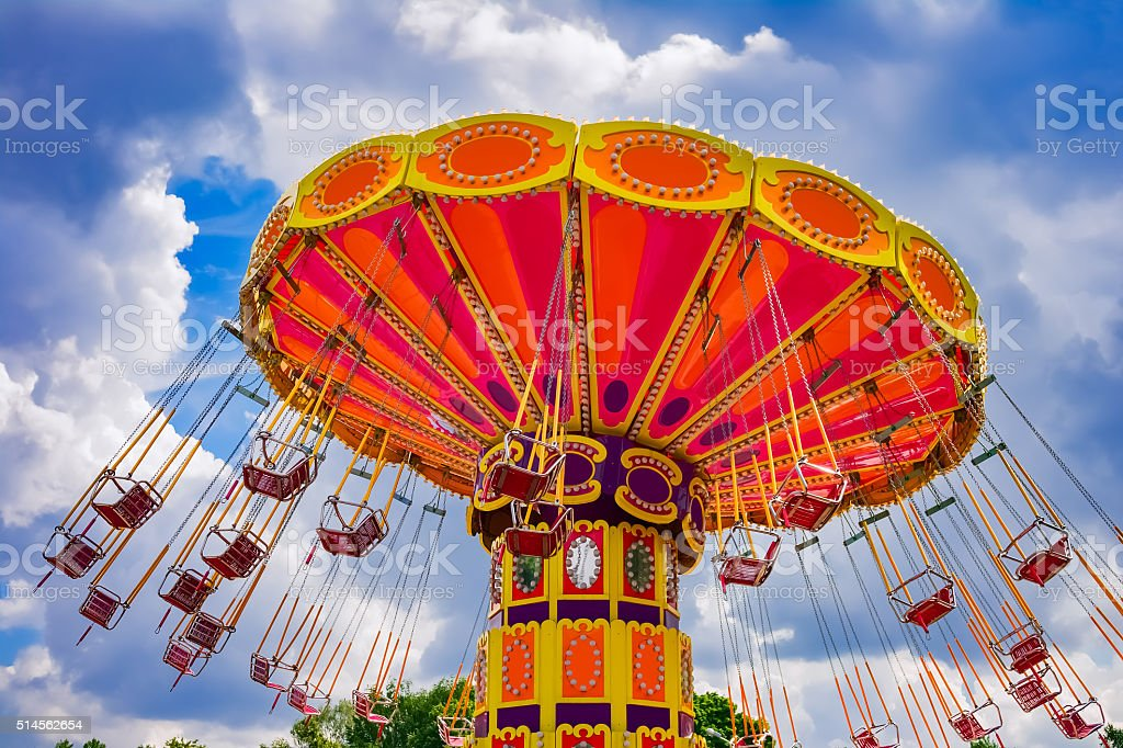 Colorful swing ride stock photo