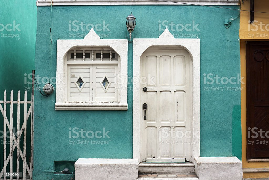 Colorful Teal Building Exterior Door and Window Facade, Mexico Style royalty-free stock photo