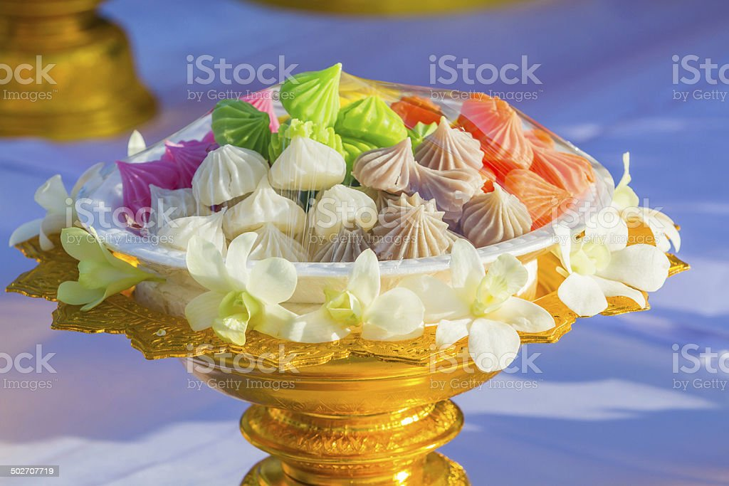 Colorful thai dessert on a golden tray with pedestal. royalty-free stock photo